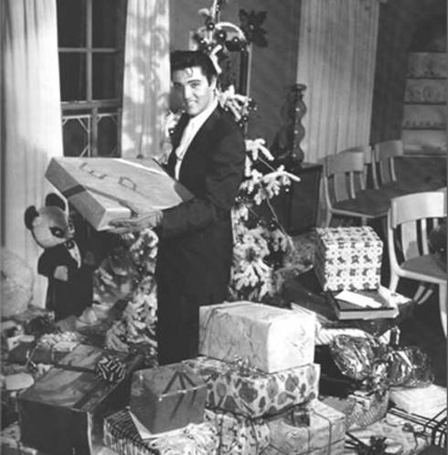 Elvis celebrating Christmas at Graceland in 1957