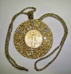 Elvis Presley auction - gold and diamond medallion